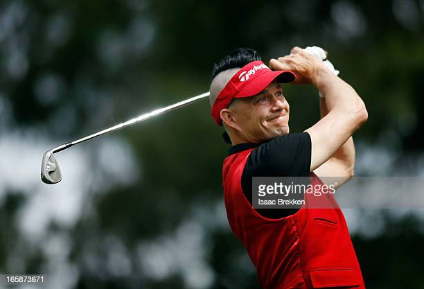 No Doubt drummer Adrian Young hits a tee shot during ARIA Resort Casino's Michael Jordan Celebrity Invitational golf tournament at Shadow Creek on...