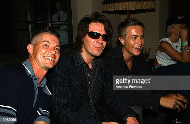 'No Doubt' drummer Adrian Young poses with guitarist Andy Taylor and his son Andy Jr at an afterparty at the Chateau Marmont on July 15 2003 in...