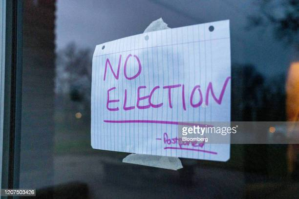 A No Election sign hangs on the door of a polling station in Dayton Ohio US on Tuesday March 17 2020 Ohio GovernorMike DeWineinvoked a health...