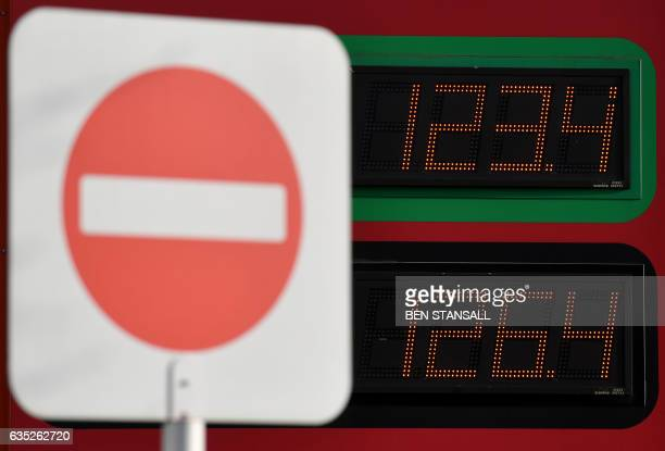 A 'no entry' sign is pictured in front of a display board showing the price of unleaded and diesel fuels at a supermarket service station in...