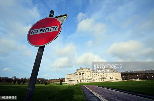 A 'No Entry' sign is pictured in front of the Parliament Buildings at Stormont in Belfast on January 25 2017 Northern Ireland will hold snap...