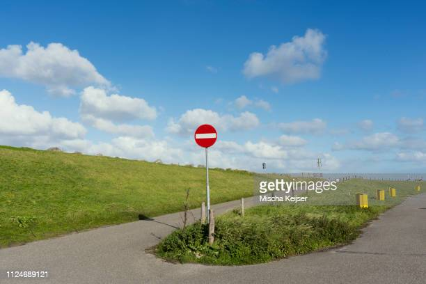 no entry sign on dyke cycle path, netherlands - south holland stock pictures, royalty-free photos & images