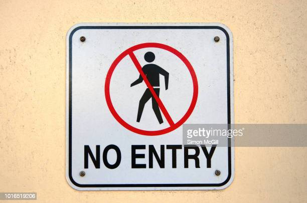 'no entry' sign on the exterior wall of a building - forbidden stock pictures, royalty-free photos & images