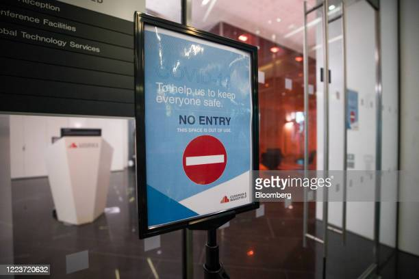 A No Entry sign stands at the entrance to a communal area at Cushman Wakefield Plc's offices during the first phase of the reoccupation of their...
