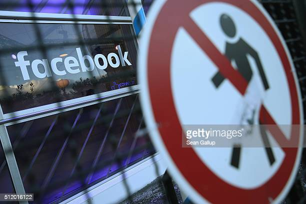 A no entry symbol hangs on an opened gate next to the Facebook logo at the Facebook Innovation Hub on February 24 2016 in Berlin Germany The Facebook...