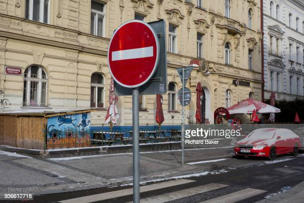 A No Entry traffic sign and a background of a redthemed restaurant on 18th March on Smeralova Street in Prague 7 the Czech Republic