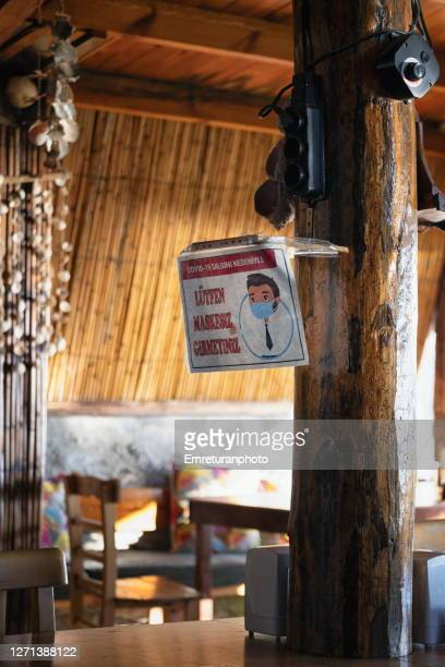 no entry without a mask sign in a cafe in aegean turkey. - emreturanphoto stock pictures, royalty-free photos & images