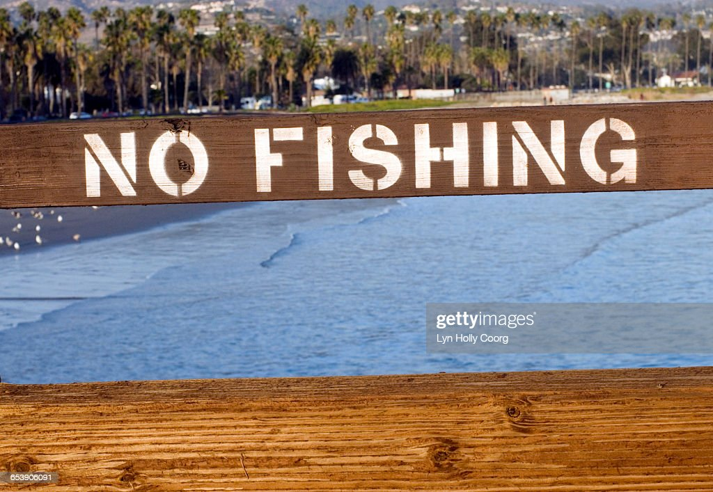 No Fishing sign with sea in background : Stock Photo