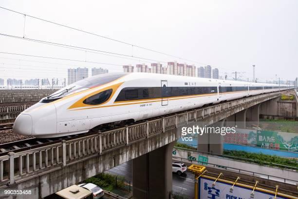No G118 Fuxing bullet train runs out of Nanjing South Railway Station on July 1 2018 in Nanjing Jiangsu Province of China New longer Fuxing bullet...