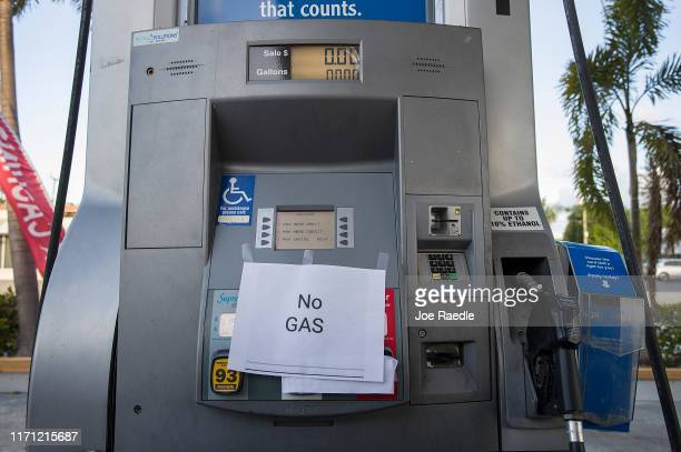 A 'No Gas' sign is seen on a gas pump at a station after it ran out of gas as people get fuel before the arrival of Hurricane Dorian on August 30...