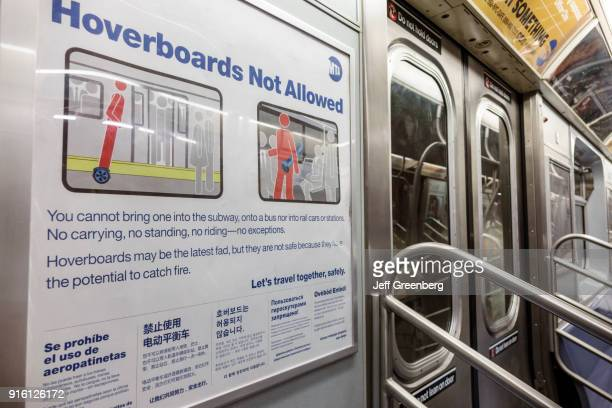 A no hover boards sign on a train in Financial District