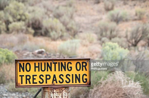 No hunting or trespassing in scrubland
