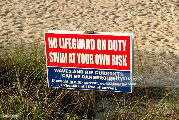 'No lifeguard on duty' sign
