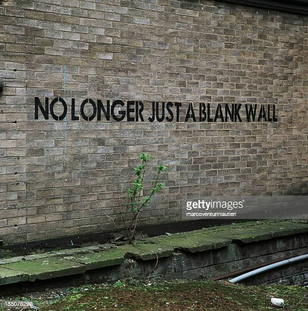 no longer just a blank wall - urban graffiti, english - marcoventuriniautieri stock pictures, royalty-free photos & images