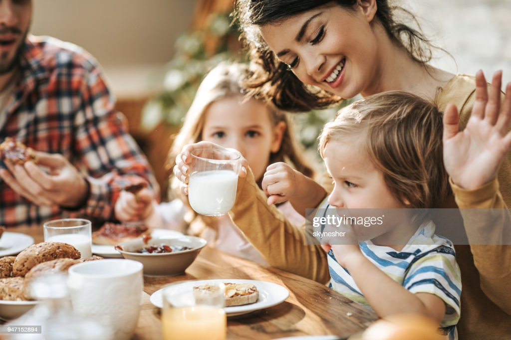 No mommy, I don't want to drink yogurt! : Stock Photo