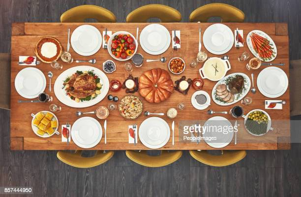 no one can say no to a good meal - dinner table stock photos and pictures