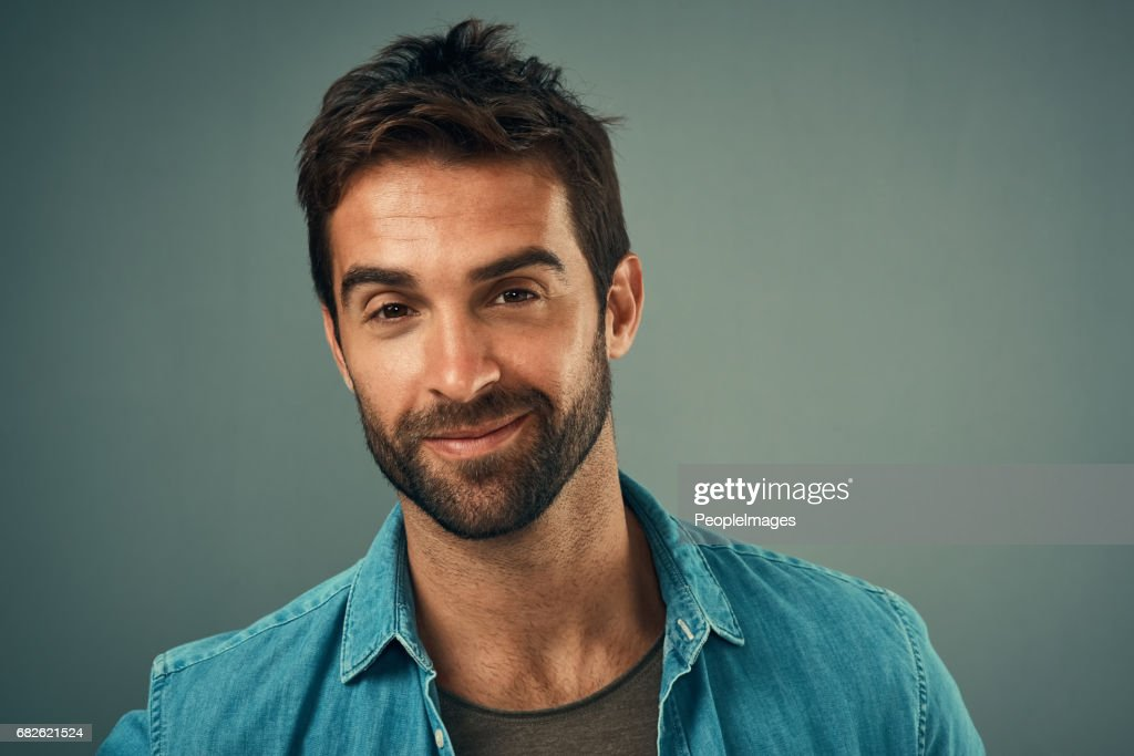 No one does cool and confident quite like him : Stock Photo