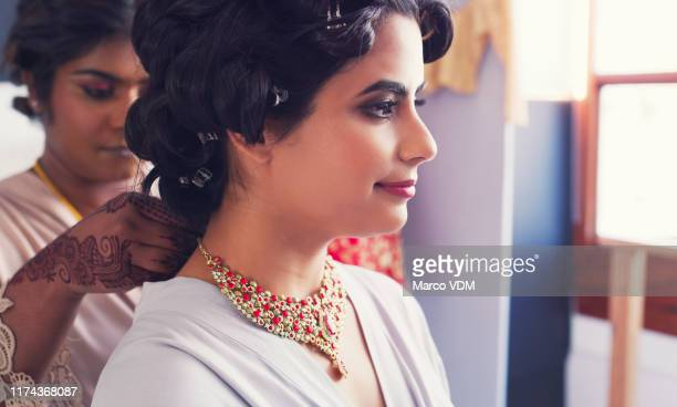 no one helps you look your best than your bridesmaid - indian wedding stock pictures, royalty-free photos & images