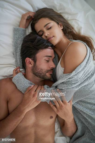 no one is immune to the cuddle - interracial wife photos stock photos and pictures