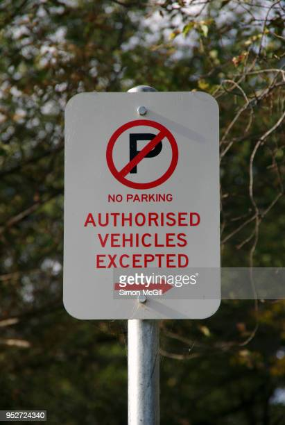 no parking - authorised vehicles excepted sign - parking sign stock photos and pictures
