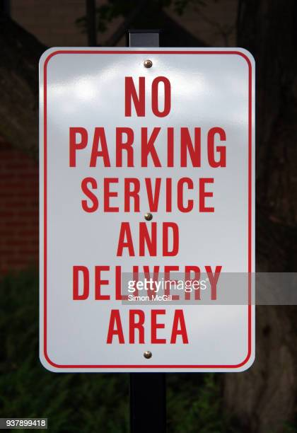 'no parking: service and delivery area' sign - parking sign stock photos and pictures
