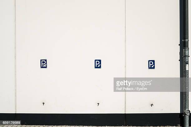 No Parking Sign On White Wall