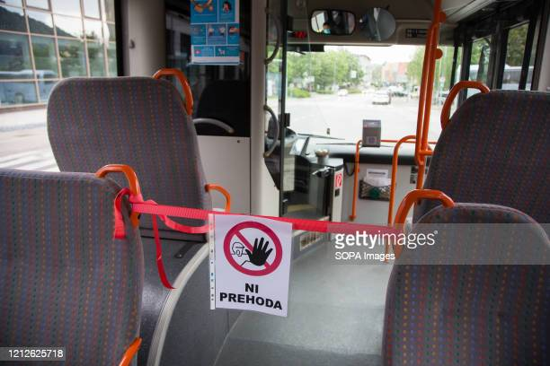 No passage sign seen inside a bus as public transport resumes under strict safety measures. Public transport in Slovenia resumed after two months of...