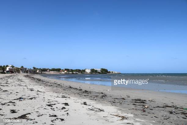 No people are seen on Siesta beach, where it is usually crowded on a Friday afternoon, as the government banned mass gathering to curb the spread of...