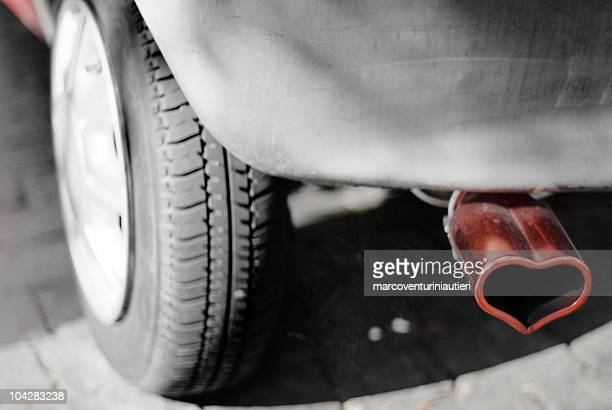 no pollution - car exhaust pipe embellished by a heart - marcoventuriniautieri stock pictures, royalty-free photos & images