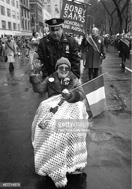 No rain on her parade Geraldine Grahl of Union City NJ who won right to 'march' is pushed by Sgt Tom Dunleavy ahead of banner proclaiming late Irish...