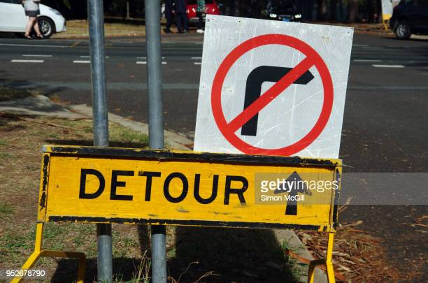 no right turn and detour signs by a roadside - detour sign stock photos and pictures