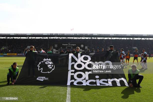 No room for racism banner is seen on the pitch prior to the during the Premier League match between Burnley FC and Wolverhampton Wanderers at Turf...