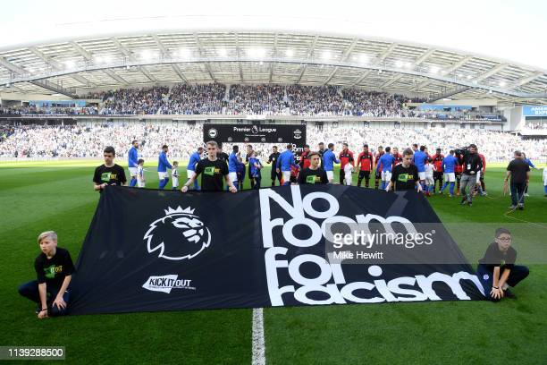 No room for racism banner is seen on the pitch prior to the Premier League match between Brighton Hove Albion and Southampton FC at American Express...