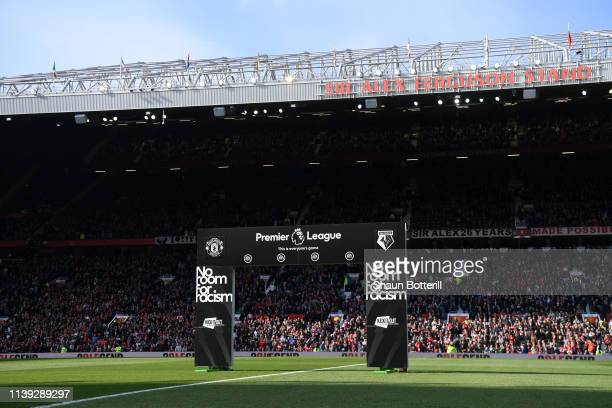 A no room for racism board is seen on the pitch prior to durin the Premier League match between Manchester United and Watford FC at Old Trafford on...