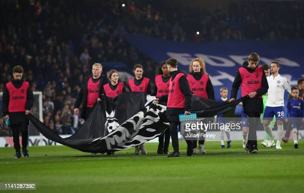 No Room For Racism campaign banner is carried prior to the Premier League match between Chelsea FC and West Ham United at Stamford Bridge on April 08...