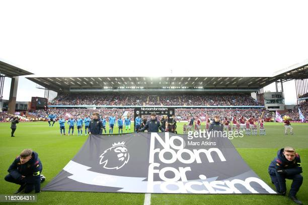 No Room for Racism flag is displayed prior to the Premier League match between Aston Villa and Brighton Hove Albion at Villa Park on October 19 2019...