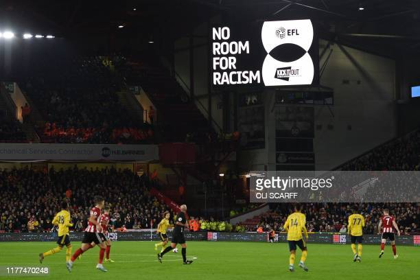 A 'No Room For Racism' message is displayed on the scoreboard during the English Premier League football match between Sheffield United and Arsenal...