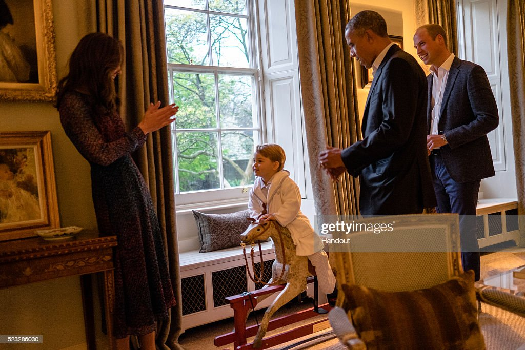 (No Sales, no commercial use whatsoever of the photographs (including any use in merchandising, advertising or any other non-editorial use) In this handout provided by Kensington Palace, President Barack Obama talks with the Prince William, Duke of Cambridge as Catherine, Duchess of Cambridge plays with Prince George at Kensington Palace on April 22, 2016 in London, England. The President and his wife are currently on a brief visit to the UK where they attended lunch with HM Queen Elizabeth II at Windsor Castle and later dinner with Prince William and his wife Catherine, Duchess of Cambridge at Kensington Palace. Mr Obama visited 10 Downing Street this afternoon and held a joint press conference with British Prime Minister David Cameron where he stated his case for the UK to remain inside the European Unio