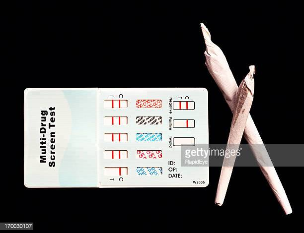 no secrets! two marijuana cigarettes next to home drug-test kit - urine sample stock photos and pictures