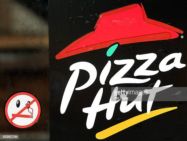 A 'No Smoking' logo is seen next to Pizza Hut signage on a door of a cigarettesmokefree Pizza Hut restaurant August 15 2005 in Niles Illinois...