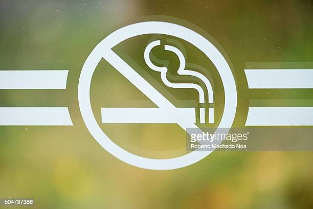 No smoking sign Do not smoke sign on glass with blurred background