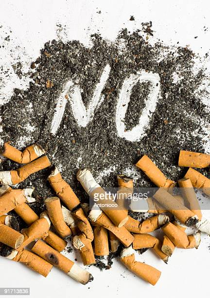 No smoking sign made of cigarette butts and ash