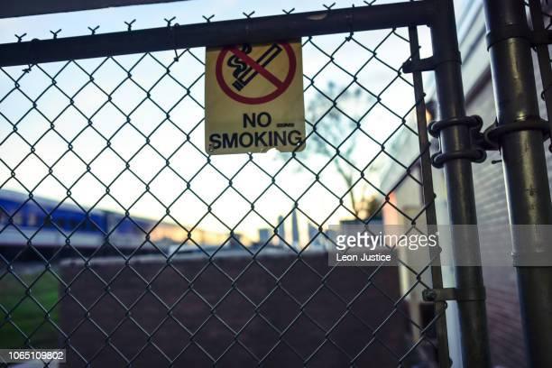 No smoking sign on fence