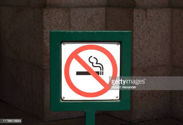 A 'no smoking' sign outside a restaurant in downtown Denver Colorado