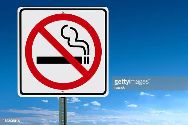 No Smoking Sign Post Over a Blue Sky Background