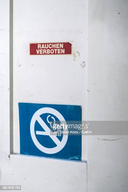 No Smoking Sign With Text On Wall