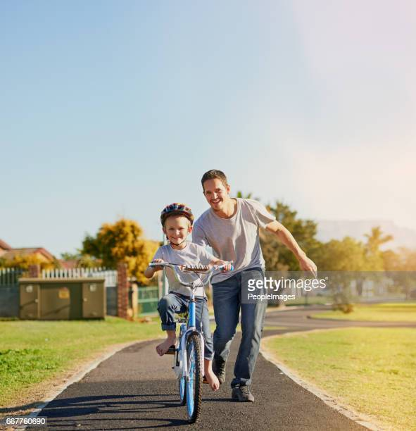 no training wheels needed! - riding stock photos and pictures