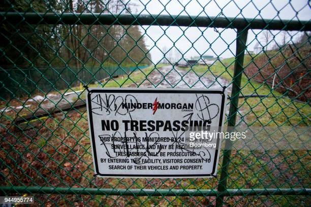 A 'No Trespassing' sign is displayed on a fence outside of the Kinder Morgan Inc facility in Burnaby British Columbia Canada on Wednesday April 11...