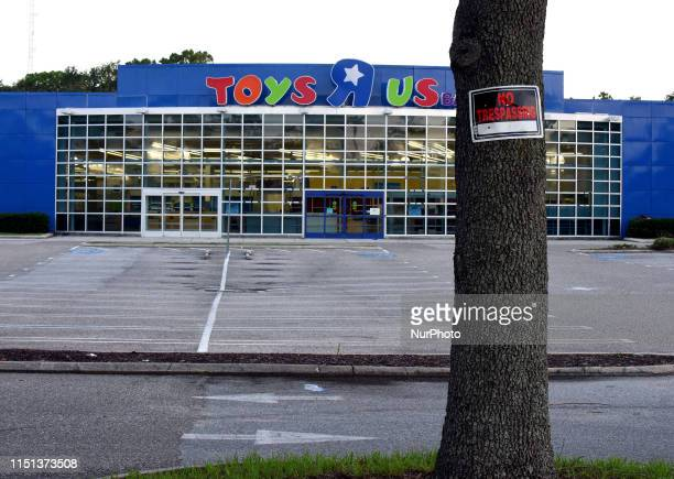 No Trespassing sign is seen on a tree at a shuttered Toys R Us store on June 21, 2019 in Orlando, Florida. Toys R Us is reportedly planning to reopen...