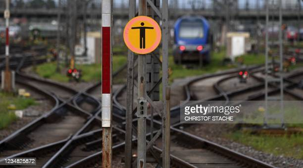 No trespassing sign is seen on railtracks at the main railway station in Munich, southern Germany, on August 23, 2021 during a strike called by the...